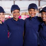 portrait of beautiful young textile factory co-workers